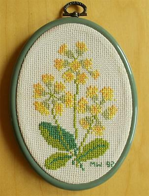 Swedish hand-cross-stitched oval picture,  Narke region flower Cowslips