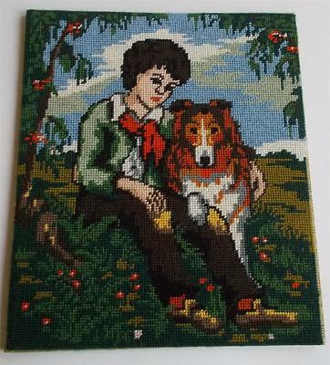 Swedish wool needlepoint picture, sitting young boy with his collie at his side