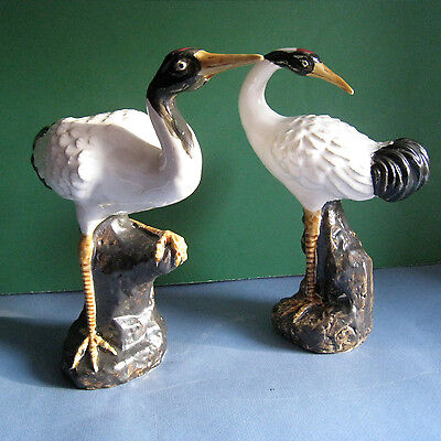 """Elegant Pair of Porcelain Cranes in different poses each stands 9"""" tall"""