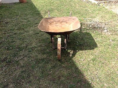 antique steel wheeled wheelbarrow