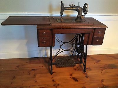 Antique Treadle sewing machine. Oak cabinet. PICKUP ONLY. CANNOT BE SHIPPED.