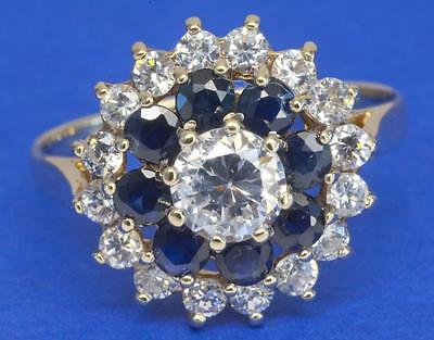 A VINTAGE SOLID 9ct GOLD CREATED DIAMOND & SAPPHIRE CLUSTER RING SIZE O (7.25)