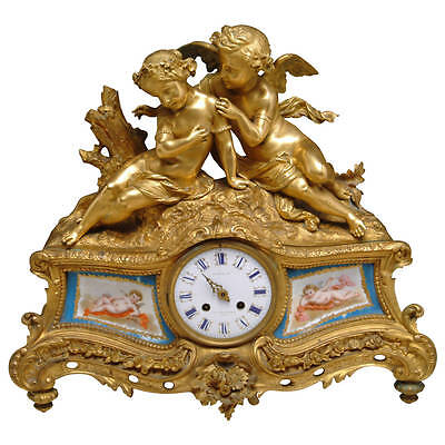 A 19th Century French Gilt Bronze & Sevres Style Porcelain Figural Mantel Clock