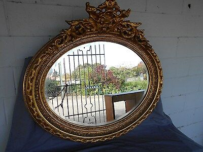 Large Ornate Oval Gilt Mirror With Bevelled Glass