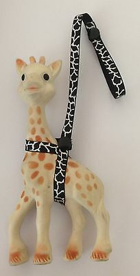 Toy Saver Strap for sophie the giraffe/fan fawn/toys* Black snap cow print.