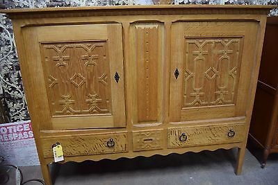 Carved Light Wood Cabinet with Metal Hardware