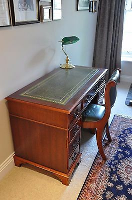 Antique reproduction mahogany pedestal desk and matching leather chair