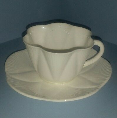 Vintage Shelley English china cup and saucer. Dainty shape. White