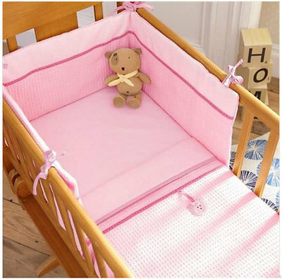 Brand new in pack Izziwotnot pink gift two piece crib set quilt and bumper