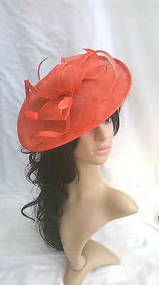 NEW DEEP CORAL SINAMAY & FEATHER FASCINATOR HAT.Shaped saucer disc,Wedding.