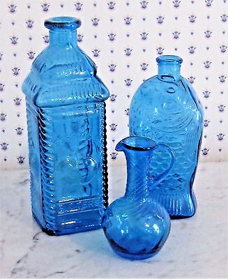 Assortment Of Three Vintage Blue Glass Bitter's Bottles and Vase