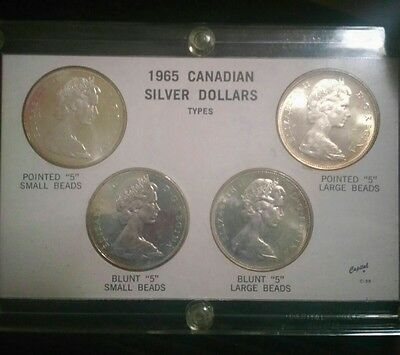 1965 Canadian Silver Dollars. 4 Types. Uncirculated. Au. No Reserve.