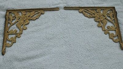 Large pair of ornate cast iron Victorian style brackets with cherub design.