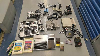 Lot of Video Game Console with components, game cartridges & controllers Vintage