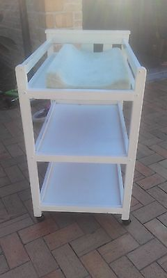 white wooden baby change table