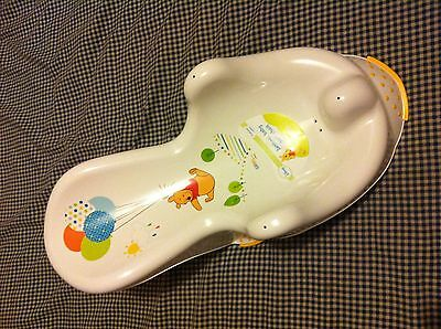 Disney Baby Winnie the Pooh Bath Chair for newborns, with suction pad.