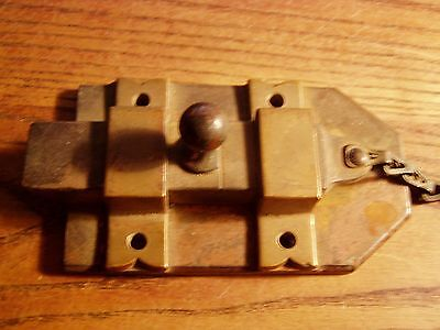 Antique  iron spring loaded door catch with brass hold downs