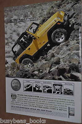 2004 Jeep Rubicon advertisement, yellow off-road JEEP climbing mountain