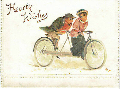Victorian Christmas Greetings Card Anthropomorphic Robins Riding A Bike Embossed