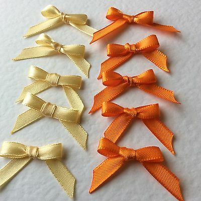 10 Pretty Orange/Cream 6mm Ribbon bows -card making/scrap booking  -help charity
