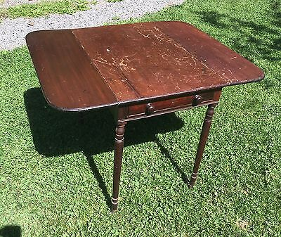 Late 19th c. mahogany drop-leaf table with drawer and turned legs