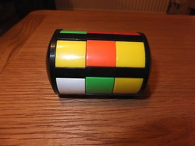 cylindrical vintage twist puzzle game like a RUBIKS CUBE
