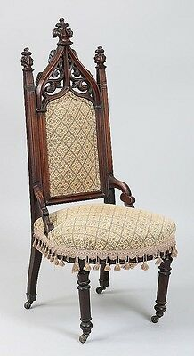 19th century carved mahogany cathedral chair Lot 161