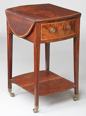 19th Century, small mahogany oval drop leaf table Lot 162