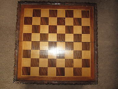 A large vintage carved and inlaid folding chess board