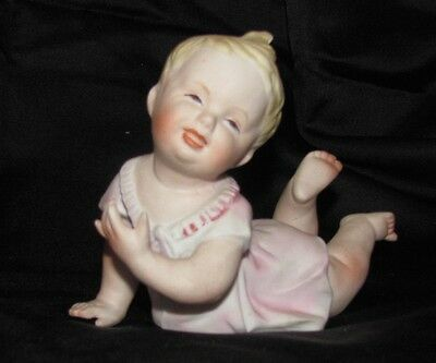 """Vintage Piano Baby Figurine  """"unbounded Joy""""  Bisque-- Perfect Codition"""
