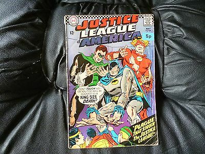 Justice League of America # 44 has seen better days spine tatty