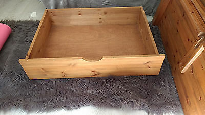 2 solid pine underbed drawers with castors waxed medium oak colour