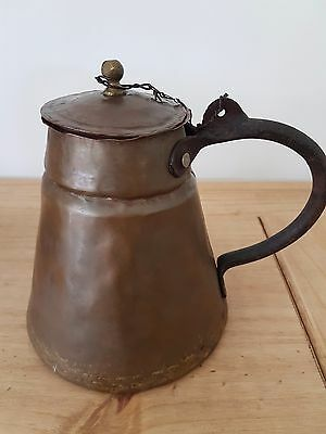 copper antique jug with primitive handle