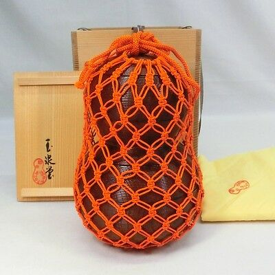 D320: Japanese tier of lacquered boxes JUBAKO of gourd shape with net w/box.
