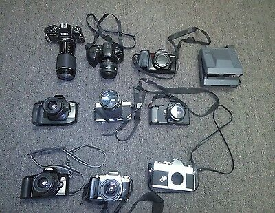 lot of broken cameras for parts or repair
