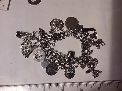Sterling Silver Charm Bracelet With 17 Charms - 70 Grams