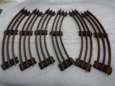 Hornby O Gauge 6 electrical curved rails with connecting plates.