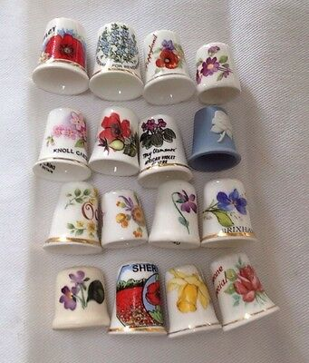 16 Ceramic thimbles: Flower themes.
