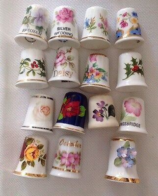 15 Ceramic thimbles of Flower Themes. No blemishes.