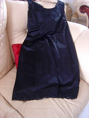 Vintage Black Slip.Underskirt. Size 14 ..with a lovley lace trim..Naughty 50`s