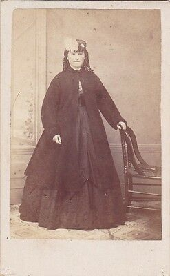 1860s CDV Young Woman Wearing Cloak Tight Curls Hat With Feathers Studio Photo
