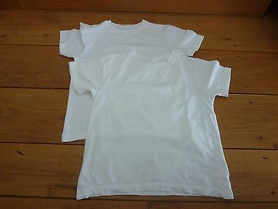 2 white short sleeved t shirts age 7 - 8 years great condition