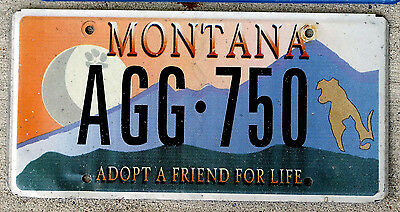Montana Adopt a Friend For Life License Plate with a Paw Print on the Moon