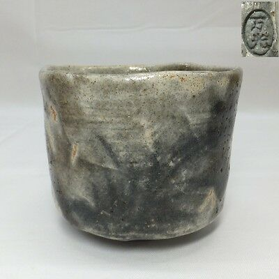 E395: Japanese SHINO pottery tea bowl of good style of glaze with potter's sign