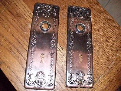 2 antique door knob backplates