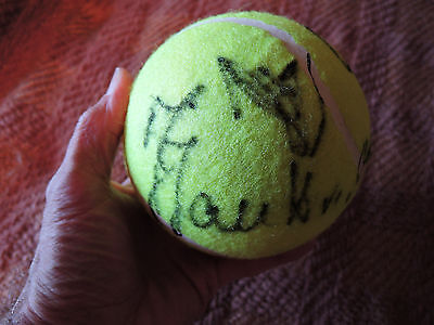 About 13 years old (2003) big tennis ball signed by 5 or 6 WTA female players