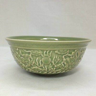 D797: Chinese blue porcelain bowl with dragon relief and appropriate tone