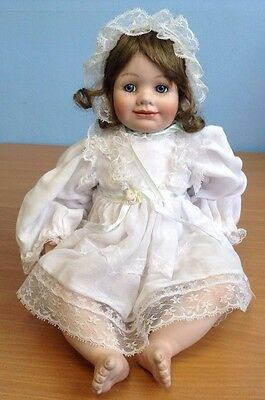 Porcelain Baby Doll Figure with Bonnet