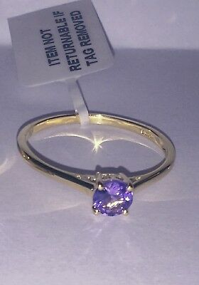 0.5 CT Tanzanite gold ring 9 carat yellow gold solitaire