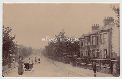 Manchester - Rock Road street view looking towards Stretford Road RP postcard